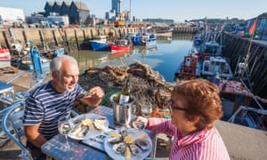 Eating oysters in Whitstable, Kent.