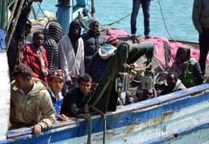 Migrants arrive at the port in the Tunisian town of Zarzis, some 50km west of the Libyan border, following their rescue by Tunisia's coast guard and navy after their vessel overturned off Libya, on 13 April 2015.