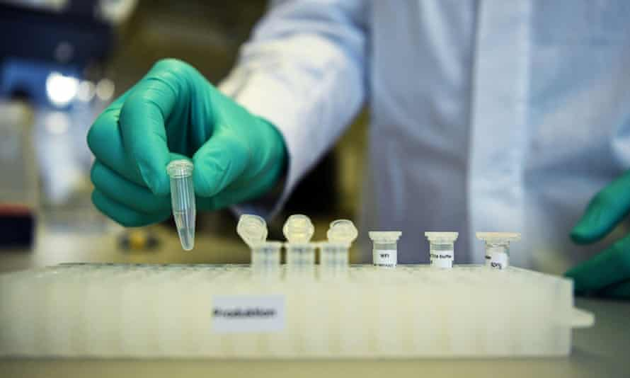 A researcher at the German biopharmaceutical company CureVac demonstrates work on a vaccine for the coronavirus at its laboratory in Tübingen.