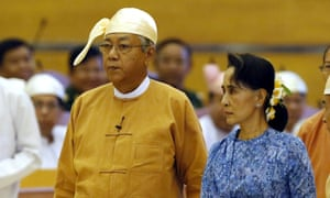 Myanmar's new president Htin Kyaw arrives with Aung San Suu Kyi at the parliament in Naypyitaw.