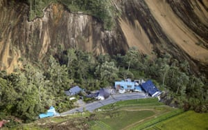 Houses are damaged by a landslide caused by an earthquake in the town of Atsuma on Japan's northern island of Hokkaido.
