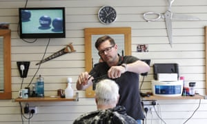 Shields Road barber Steve Compton cuts a customer's hair.