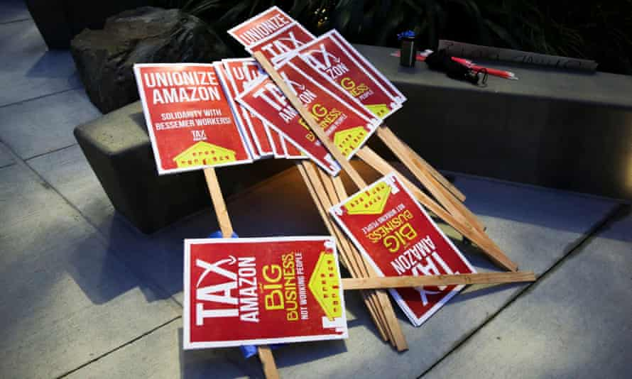 Signs supporting Amazon workers trying to unionize in Bessemer, Alabama, are seen in Seattle, Washington, on 20 February.