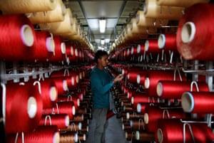 Al-Muwaqar, Jordan. An employee examines the threads at a carpet factory