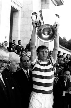 Billy McNeill holding the European Cup trophy aloft after beating Inter Milan in Lisbon, Portugal, in 1967.