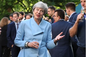 London, EnglandBritain's Prime Minister Theresa May gestures as she speaks with England's players in the garden of 10 Downing Street during a reception a day after they won the 2019 Cricket World Cup after beating New Zealand the final at Lord's