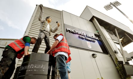 A statue of Michael Jackson outside Craven Cottage is removed in 2013.