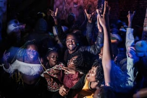 People celebrate after counting down to the new year in a bar in Kibera in Nairobi, Kenya