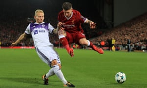 Maribor's Martin Milec gets the better of Liverpool's Alberto Moreno and wins the ball.