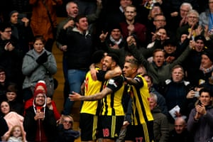 Watford's Andre Gray (centre) celebrates with teammates Troy Deeney (left) and Roberto Pereyra after scoring