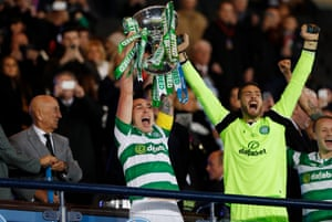 Scott Brown and Craig Gordon celebrate winning the final with the trophy.