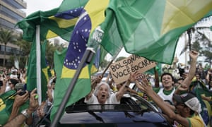 Supporters of Brazilian presidential candidate Jair Bolsonaro cheer as they gather outside his residence in Rio de Janeiro, during the country's presidential runoff election.