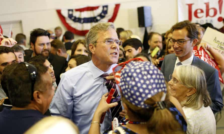 Jeb Bush allows supporter Roxanna Greene, of Hialeah, FL, to loosen his tie during a rally on his 'Jeb Can Fix It' tour, on Monday in Tampa, Florida.