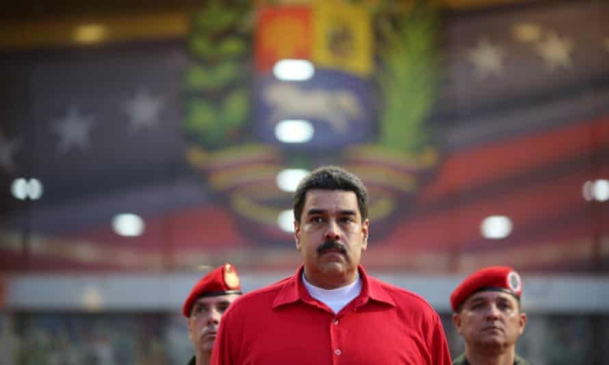President Nicolas Maduro receives military honors at Maiquetia airport, in Caracas, Venezuela on Thursday.