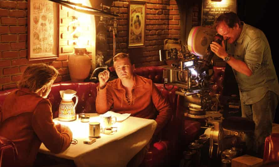 Quentin Tarantino films Leonardo DiCaprio (centre) and Brad Pitt on the set of Once Upon a Time in Hollywood.