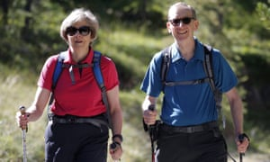 Theresa May walking in a Swiss forest with her husband, Philip, in August 2016.