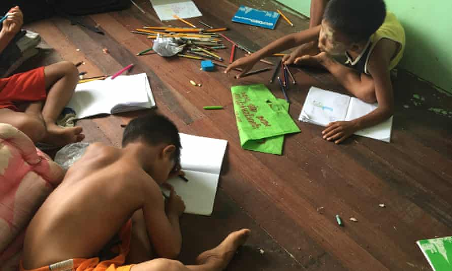 Children draw at a private orphanage in Myanmar.