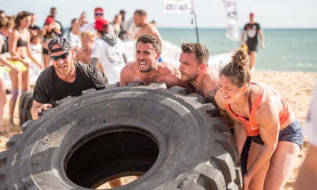 Competitors at Tribal Clash with giant tyre