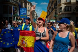 British nationals and other protesters in Málaga wave EU and Spanish flags as they take part in a demonstration against Brexit.