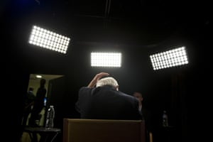 Bernie Sanders fixes his hair before an interview with The Associated Press.