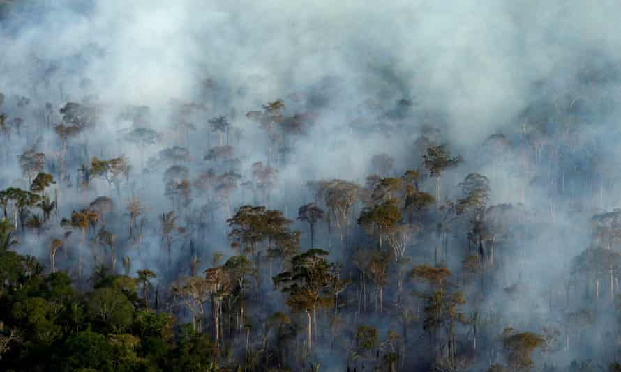 Smoke billows during a fire in an area of the Amazon rainforest