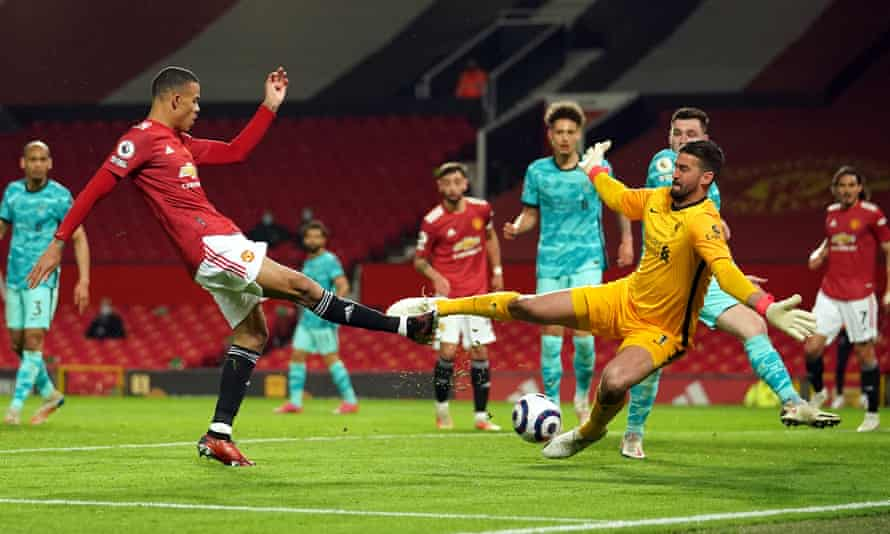 Alisson saves from Manchester United's Mason Greenwood at Old Trafford in May.