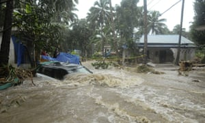 Floodwaters rush through Kozhikode, Kerala state.