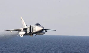 The Russian jet passes a US destroyer ship in Baltic Sea last week.