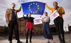 Edinburgh university students holding EU flag: Andrew Wilson (president) leopard print; Oona Miller (vice president) black top red skirt; Rosheen Wallace (vice president community) blue trousers; Stephanie Vallency (vice president education) yellow jacket