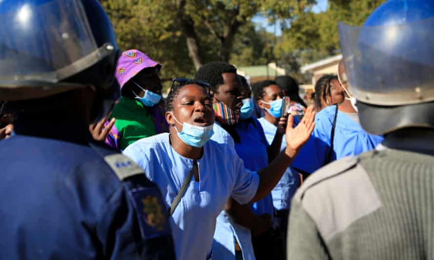 A nurse confronts the police during a protest in Harare.