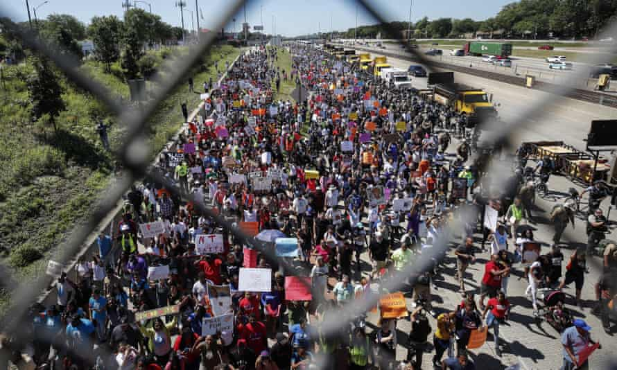 Thousands of activists march onto Chicago's Dan Ryan Expressway on Saturday