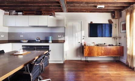 The open living area/kitchen with exposed beams.