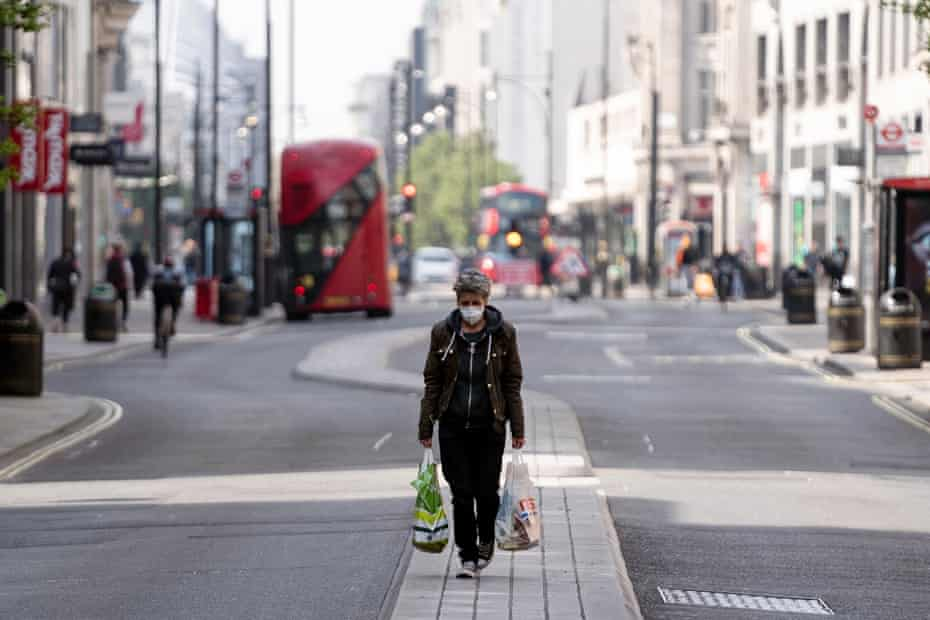 A shopper walks down the usually bustling Oxford Street in central London.