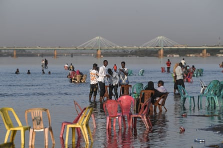 Families gather by the shallow waters of the Nile River at Tuti island in Khartoum, where the Blue Nile and the White Nile meet to become the Nile river