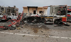Damaged vehicles at Mitiga airport in Tripoli after it was hit by shelling