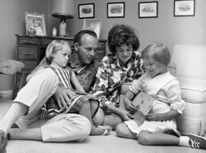May 1962. Palmer with his wife, Winnie, and their children, Amy, three, left, and Peggy, six, at their home in Latrobe, Pennsylvania. Peggy is displaying a picture she painted of a golf Green.