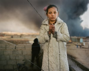 Luma, 12, lives next door to a burning oil well in Qayyarah, Iraq. More than 15 wells in the town were set alight by Isis as they retreated