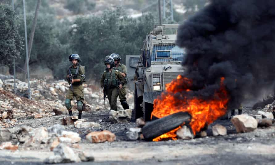 Israeli soldiers during clashes with Palestinians