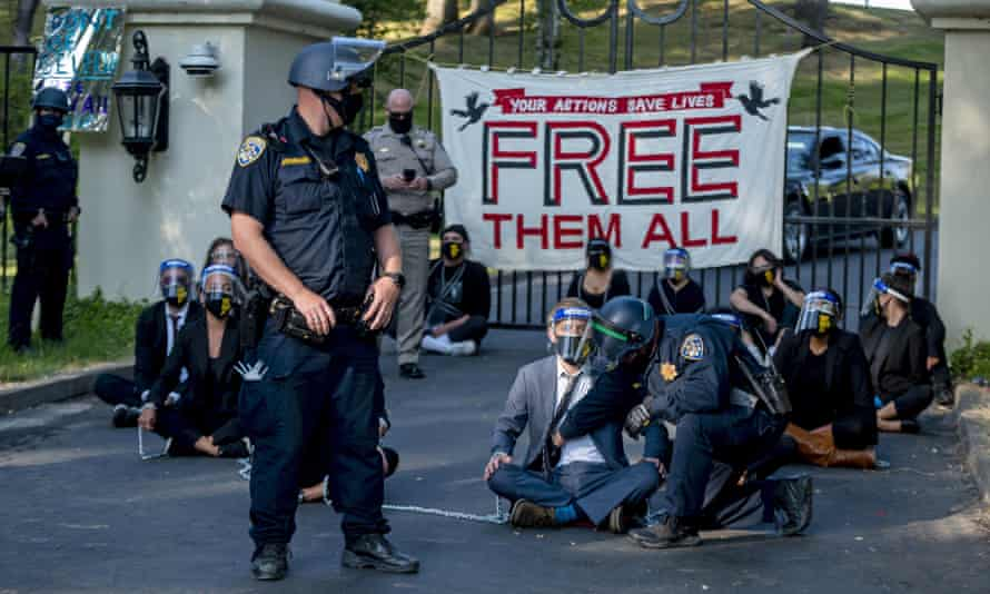 Demonstrators calling for mass prison inmate releases protest outside of Gavin Newsom's mansion in Fair Oaks, California.