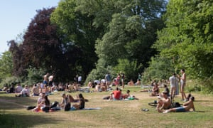 Members of the public sunbathing in Hampstead Heath on June 02, 2020 in London, UK, after the British government eased restrictions, allowing groups of six people from different households to meet in parks and gardens, subject to social distancing rules.