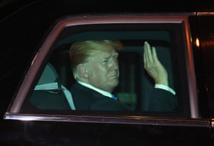 The US president, Donald Trump, waves to reporters as he arrives at the Shangri La hotel in Singapore.