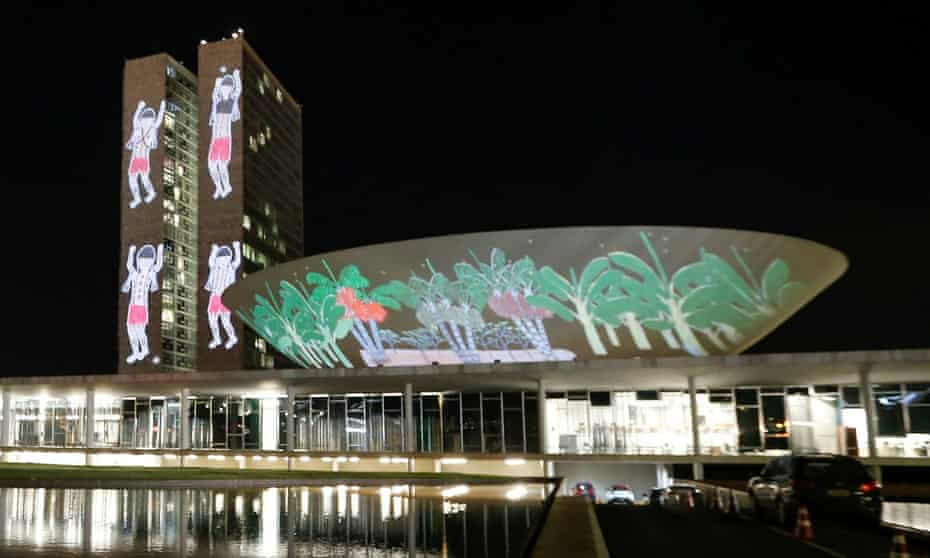 A projection on the building of the National Congress with drawings of the Yanomami xapiri, the spirits of the Forest, is seen during a protest to evict illegal goldminers from Brazil's largest indigenous Yanomami reservation.