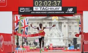 Eliud Kipchoge crosses the line to win the London Marathon in April.