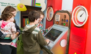 Children checking the scores on the Sparkometer, an interactive machine at the museum.
