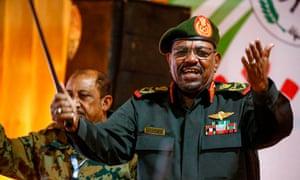Omar al-Bashir addresses a paramilitary group in Khartoum, February 2019