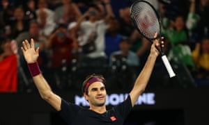 Roger Federer soaks up the applause after his win.