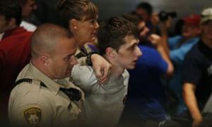 Michael Sandford is held by police during a Donald Trump speech at the Treasure Island hotel and casino in Las Vegas on 18 June 1016.