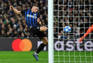 Milan Skriniar from Inter Milan can not get the shot just behind the goal of the team.
