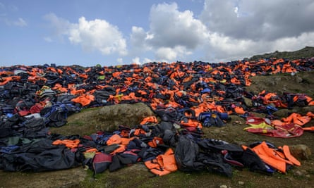 Thousands of life jackets from refugees and migrants form a small hill on the island of Lesbos, Greece