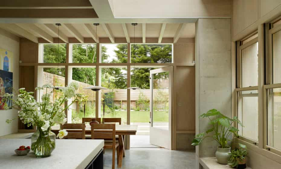 Cool and collected: the kitchen-dining room with concrete benches and garden views.